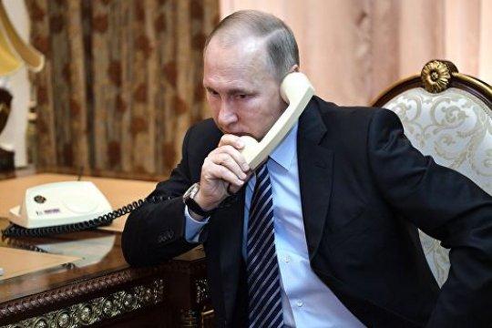 Путин, Макрон и Меркель обсудили провальную политику Порошенко