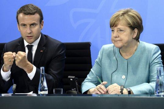Меркель и Макрон приветствовали обмен удерживаемыми лицами в Донбассе