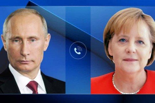 Путин и Меркель обсудили по телефону ситуацию в Ливии, Сирии и на Украине