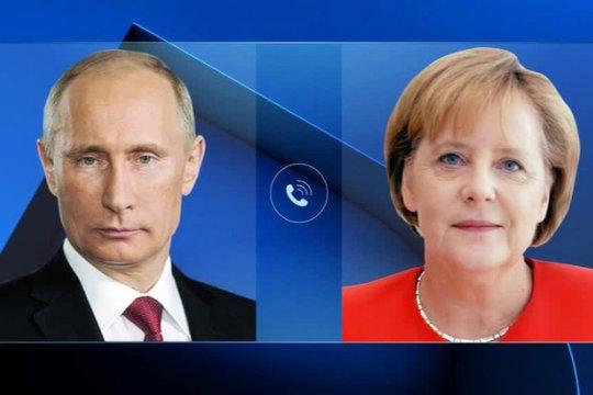 Путин и Меркель обсудили ситуацию в Сирии и Ливии
