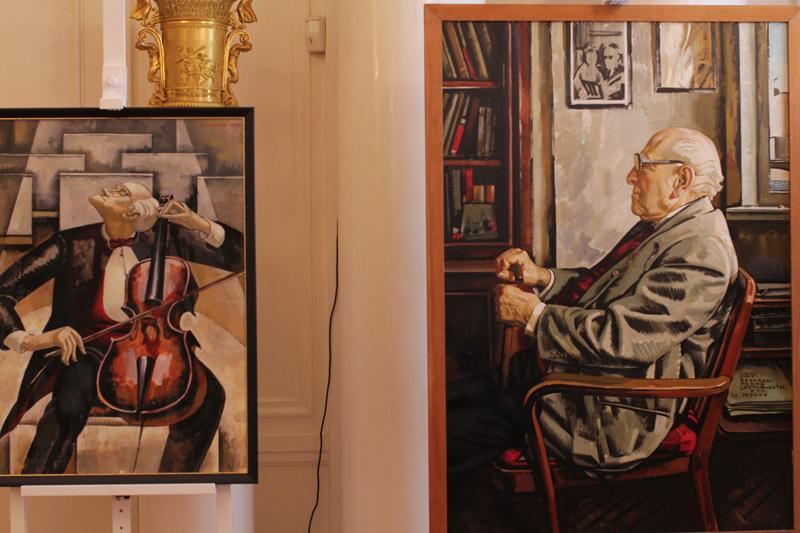 Слева направо портреты Мстислава Ростроповича и Бориса Ефимова